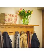 These new wooden personalised coat hooks will add a personal touch to a family hallway, boot room, kitchen or entrance hall. They are identical to our regular engraved wooden coat hooks except these feature a large flat shelf, ideal for hats and gloves.