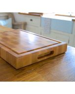 Ideal for chopping on one side and carving a roast on the other. These very special End grain chopping boards have inset side handles in the middle of the board, so you can continuously rotate the cutting board with ease. One side of the board is complet